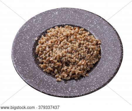 Buckwheat In Brown Plate Isolated On White Background. Buckwheat Top View. Healthy Food. Veretian Fo