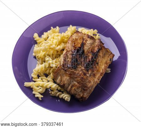 Grilled Pork Ribs With Pasta. Grilled Pork Ribs On Purple Plate Isolated On White Background. Grille