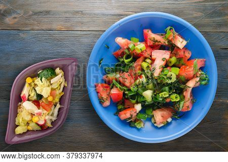Vegetarian Food . Tomatoes, Onion, Fennel On Blue Plate On Blue Grey Wooden Background. Healthy Food