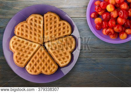 Belgian Waffles Blue Wooden Background. Waffles On A Purple Plate With Fruits Top View