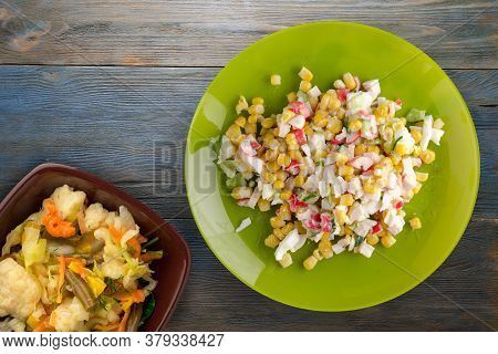 Crab Salad On Lime Plate With Vegetable Salad. Crabs Salad On Blue Grey Wooden Background Top View