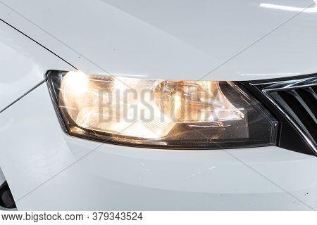 Novosibirsk/ Russia - August 01 2020: Scoda Rapid, White Car Headlights. Exterior Detail. Close Up D