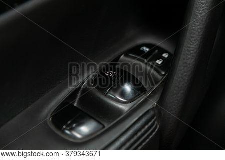 Novosibirsk/ Russia - August 01 2020: Nissan X-trail, Interior Of Modern Car. Side Door Buttons: Win