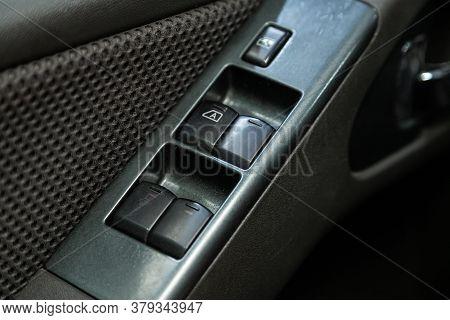 Novosibirsk/ Russia - August 01 2020: Nissan Navara, Interior Of Modern Car. Side Door Buttons: Wind