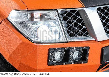 Novosibirsk/ Russia - August 01 2020: Nissan Navara, Orange Car Headlights. Exterior Detail. Close U