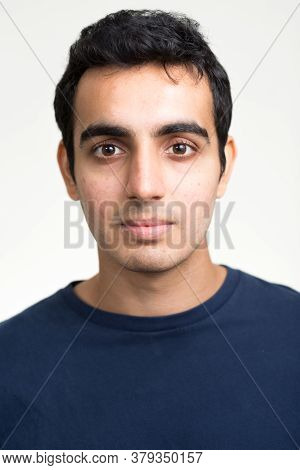 Portrait Of Young Handsome Indian Man Against White Background