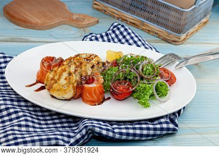 Fish Cakes With Salad, Tomatoes And Red Onions In A Restaurant On A White Plate. Red Salmon Fish. Fi