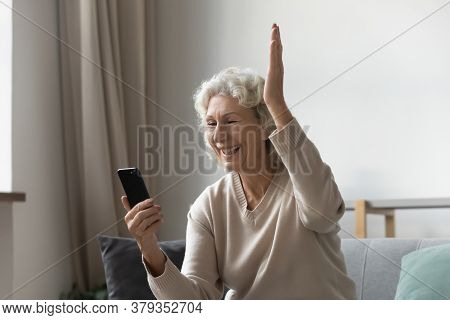Grandmother Holding Smartphone Feels Happy By Great News In Sms