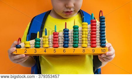 Preschooler School Student Child Holding Abacus Over Yellow Orange Background. Mental Arithmetic Sch