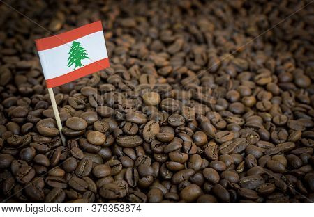 Lebanon Flag Sticking In Roasted Coffee Beans. The Concept Of Export And Import Of Coffee