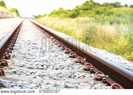 Railway With Concrete Sleeper Without The Train On Sunlight And Green Grass Background.industrial La