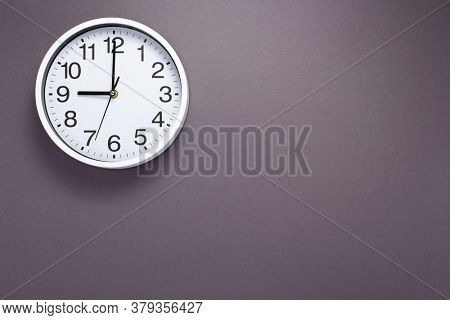 clock and shelf at wall background surface