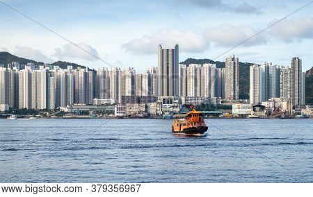 Small Orange Passenger Ferry Goes To Sai Wan Ho Ferry Pier Of Hong Kong Island
