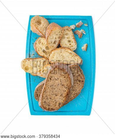 Top View Of Sliced Bread Ciabatta  On Cutting Board Isolated On White Background Closeup