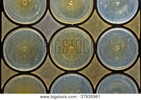 Old window with stained glass - opaque blue and yellow circles poster
