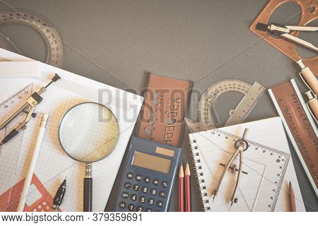 School Supplies On Dark Background, Back To School Concept. Top View With Copy Space. Vintage Toned