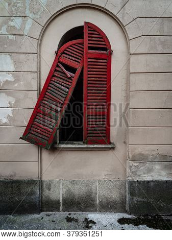 Red Doors Of A Window Of An Old Dilapidated Italian Building Of The Twentieth Century, Urbex Image