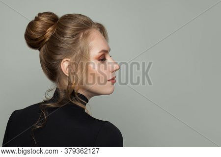 Perfect Blonde Woman With Clear Healthy Skin And Updo Hair, Profile