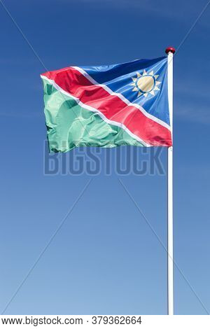 Flag Of Namibia Waving In The Sky