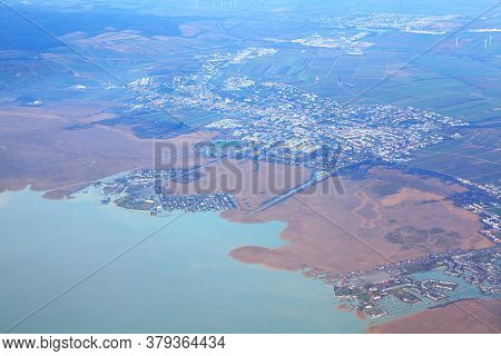 Aerial View Of Neusiedl Am See Town In Austria . Flying Over The Lake Neusiedl . Scenic Lake In Aust