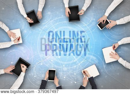 Group of people in front of a laptop with ONLINE PRIVACY insciption, web security concept