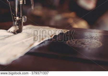 Selective Focus Of Sewing Machine Needle With Thread. Sewing Machine Head Detail And Material. Selec