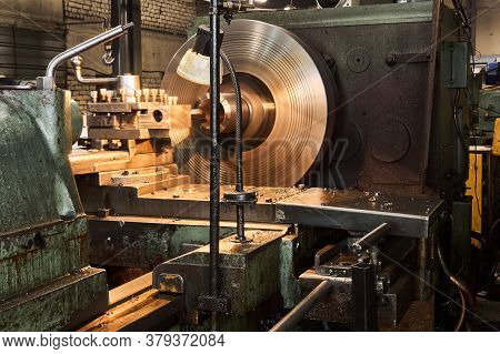 Machining A Workpiece Of A Part On A Lathe Close-up, Some Parts Are Blurred In Motion