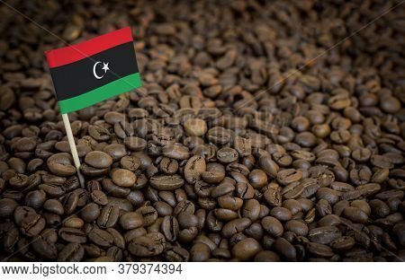 Libya Flag Sticking In Roasted Coffee Beans. The Concept Of Export And Import Of Coffee