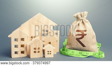 Residential Houses And A Indian Rupee Money Bag. Mortgage Loan. Buying, Fair Price. City Municipal B