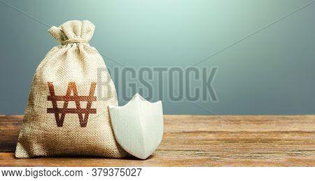 South Korean Won Money Bag And Protection Shield. Ease Doing Business. Guaranteed Deposits Insurance