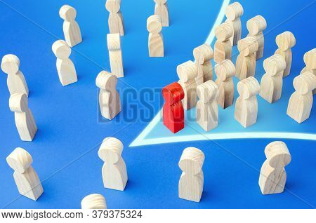 Red Leader With Followers In Arrow Formation Direction Breaks Through The Crowd. Breaking New Ground