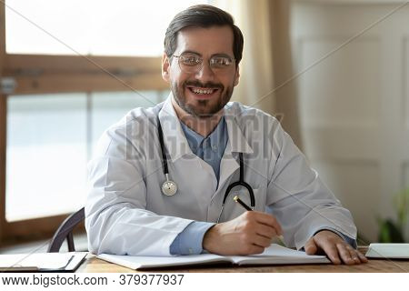 Portrait Of Smiling Young Handsome Male General Practitioner.