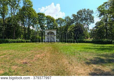 Scenic Wide-angle Landscape View Of Grassplot With Ancient Rotunda Building. It Is One Of The Famous