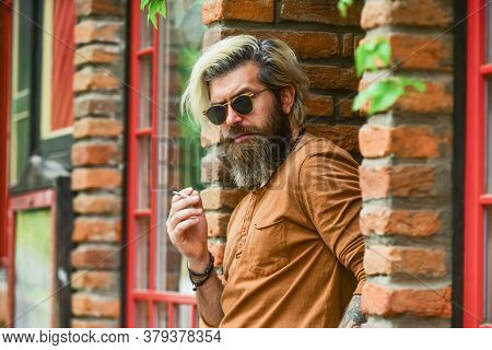 Fashionable Mature Man With Cigarette. Brutal Guy Sunglasses Smoking Tobacco. Cool Guy Relaxing. Wen