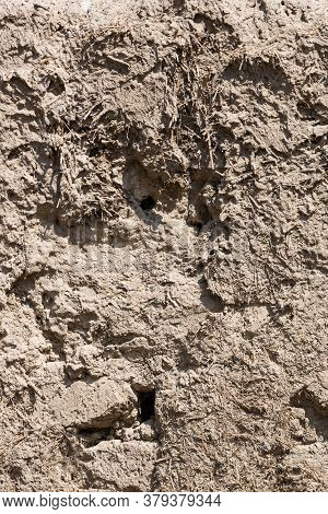 Mud And Clay Background. Old Traditional Building Material Made Of A Mixture Of Clay, Grass, Straw.