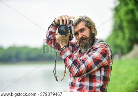 Content Creator. Masterpiece Shot. Man Bearded Hipster Photographer Hold Vintage Camera. Photographe