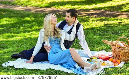 Celebrate Love. Vintage Style. Couple In Love Enjoying Picnic Time And Food Outdoors. Beautiful Peop
