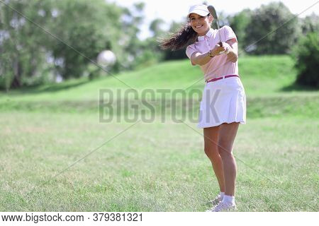 Smiling Adult Caucasian Woman In Golf Club Hitting On Ball Portrait. Active Healthy Lifestyle Concep