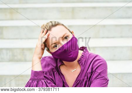 Outdoor Fashion Portrait Of Pretty Woman Wearing Purple Blouse And Facemask