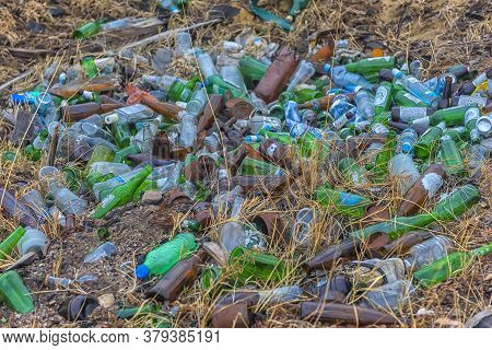 Rubbish - Plastic And Glass Bottles In A Pit On The Shore