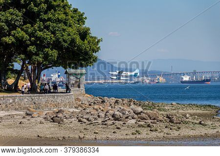 Vancouver, Canada - July 27th 2017: A Float Plane Taking Off From Coal Harbour And Passing Stanley P