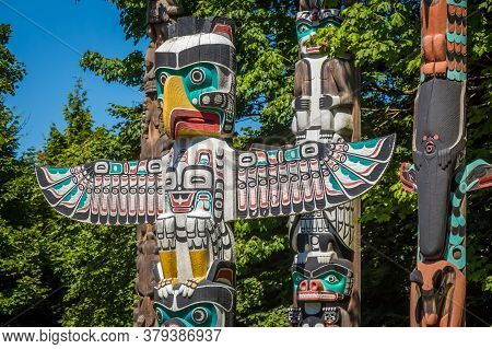 Vancouver, Canada - July 27th 2017: Close Up Of An Eagle Themed Totem Pole In Stanley Park, Vancouve