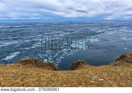 Olkhon Island In Early May, Rocks And Ice Of Lake Baikal