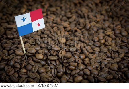 Panama Flag Sticking In Roasted Coffee Beans. The Concept Of Export And Import Of Coffee