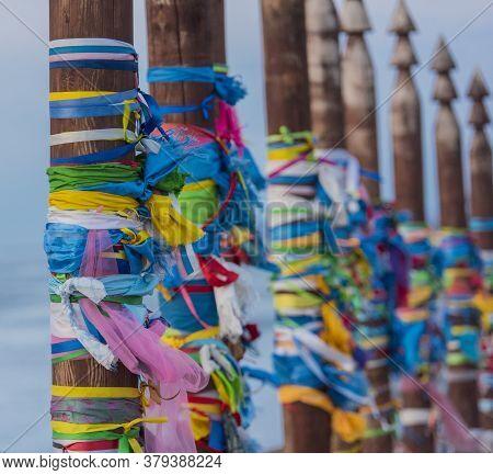 Shaman Poles Of Serge On Olkhon. Spring Landscape