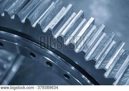 Close-up Scene  Pinion Gear Part . The Automotive Transmission Manufacturing Concept.