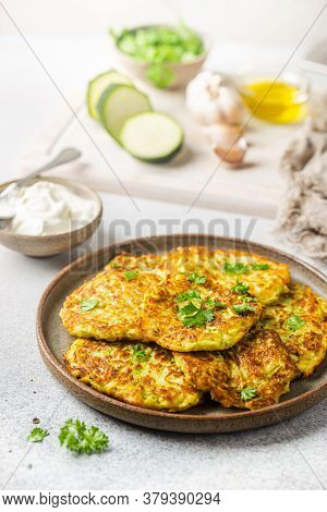 Green Zucchini Fritters, Vegetarian Zucchini Pancakes With Fresh Herbs And Garlic, Served With Cream