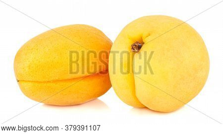 Two Fresh And Ripe Apricots Isolated On White Background