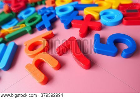 Colorful Plastic Letters On Pink Background, Close Up