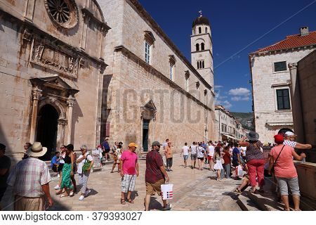 Dubrovnik, Croatia - July 26, 2019: Tourists Visit Stradun Shopping Street Paved With Polished Limes